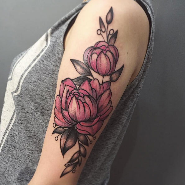A pink peony on the left arm by the lady fox