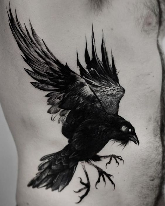 A tattered old raven tattoo on the right side