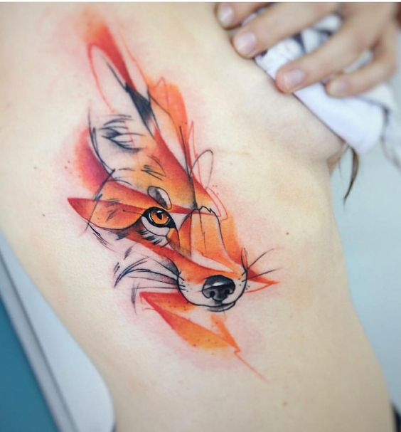 Abstract fox tattoo on the right rib cage