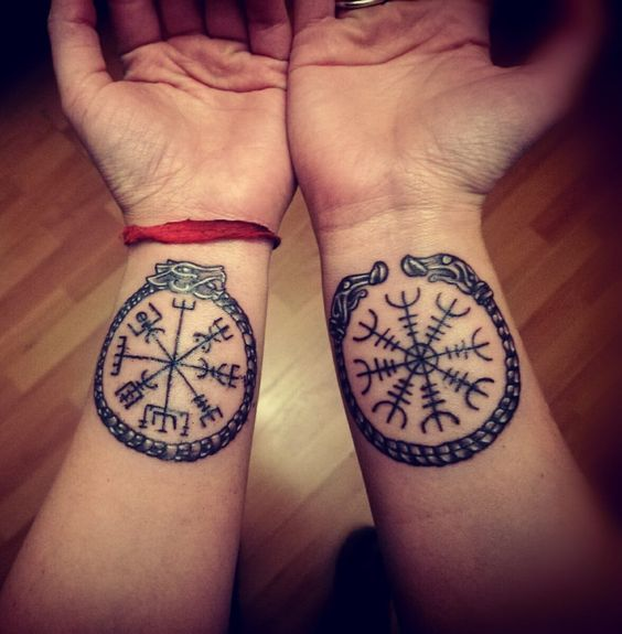 Aegishjalmur tattoo on the left wrist and vegvisir on the right