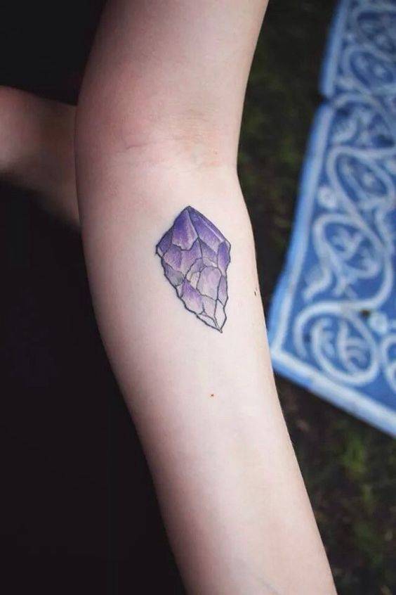 Amethyst crystal tattoo on the inner arm