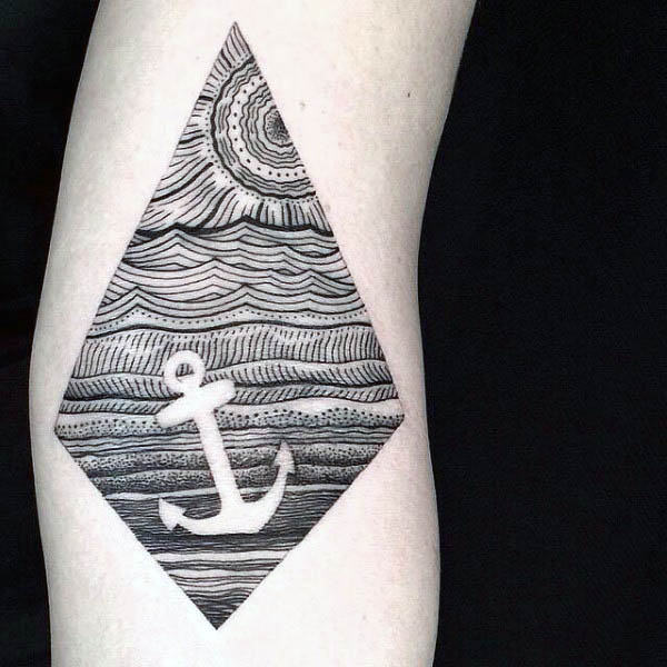 Anchor in the sea negative space tattoo