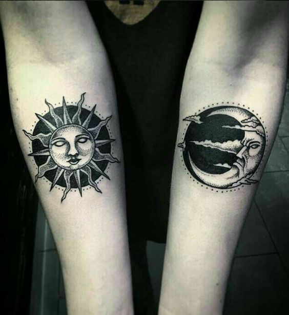 Angry moon and sleeping sun tattoo on both arms
