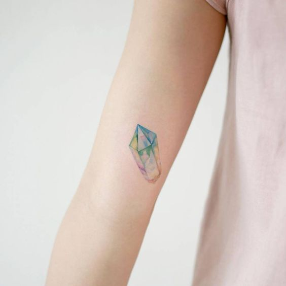 Another clear quartz crystal tattoo on the right inner arm