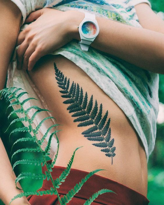 Another fantastic fern leaf tattoo on the right rib cage by olga nekrasova