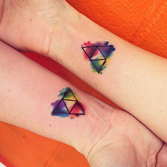 Another matching legend of zelda triforce tattoo