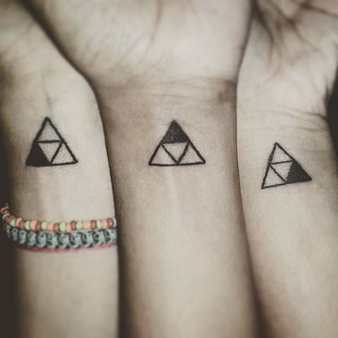 Another matching triforce tattoos for best friends or sisters with each having one symbol