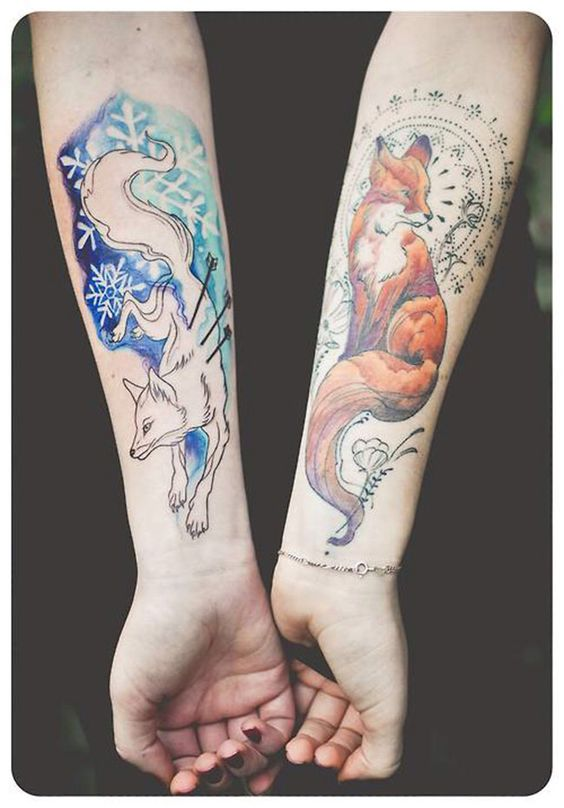 Arctic fox tattoo on the right arm and brown fox tattoo on the left
