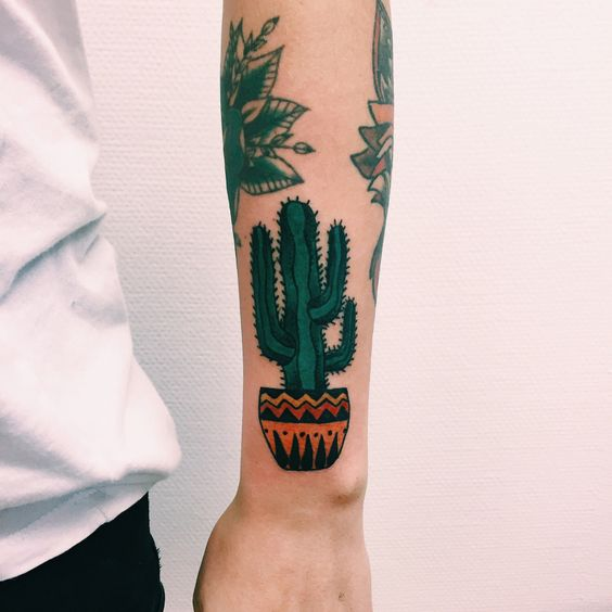 Beautiful cactus in a colorful pot tattoo on the left arm