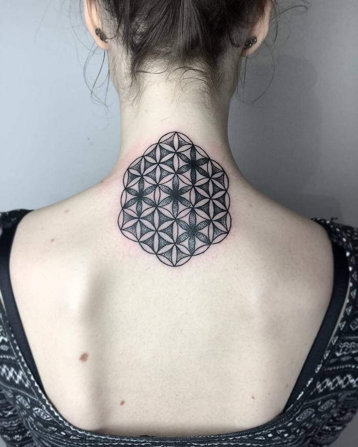 Beautiful flower of life tattoo on the back of the neck
