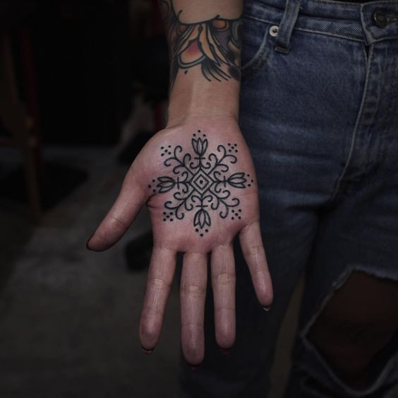 Beautiful stylized flower pattern on the palm