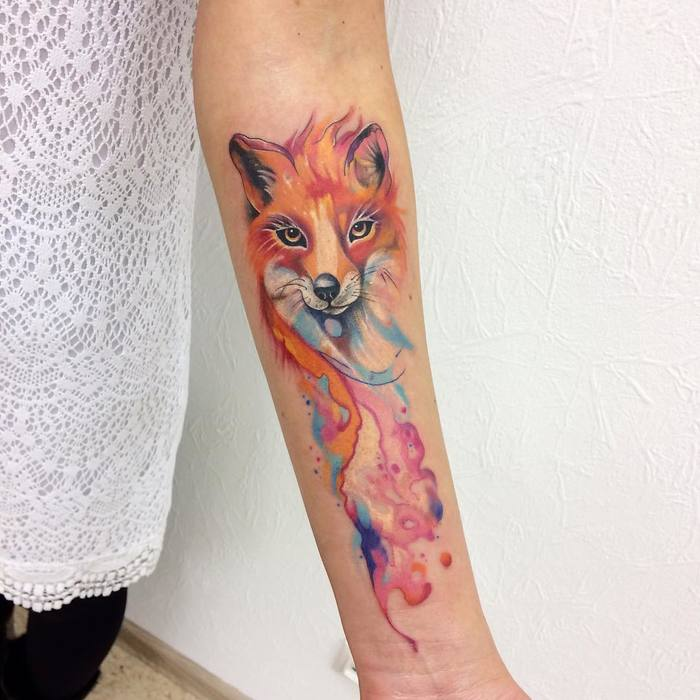 Beautiful watercolor fox tattoo on the left inner arm
