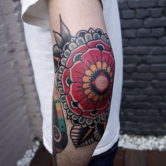 Beautifuly colored mandala tattoo on the left elbow