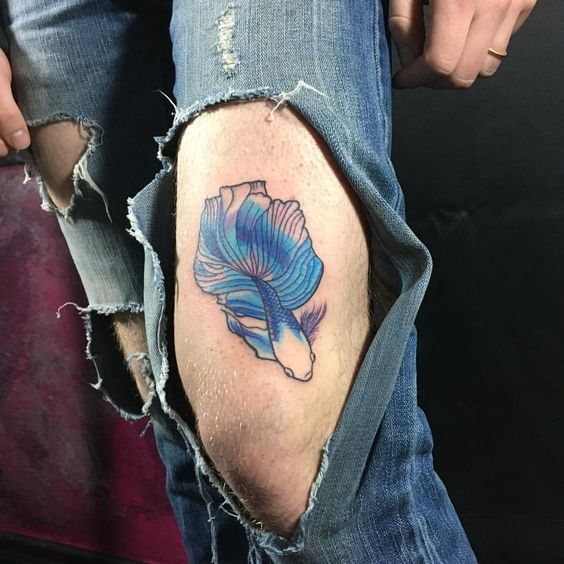Betta fish tattoo above the left knee