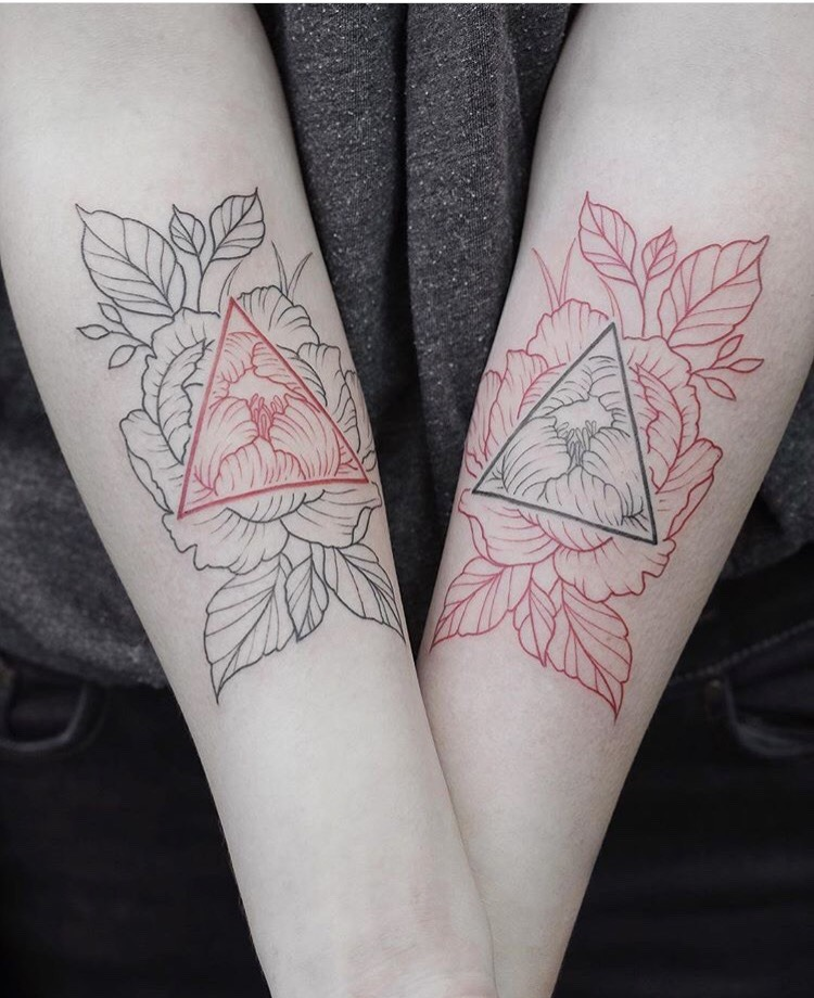 Black and red peony and triangle tattoos on both arms