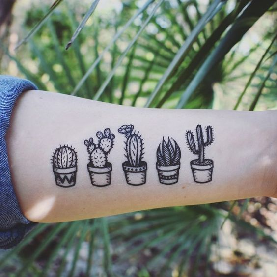 Black cacti in the pots tattoo on the left inner arm