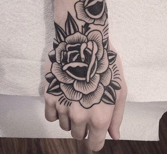 Black dot work rose tattoo on the right hand