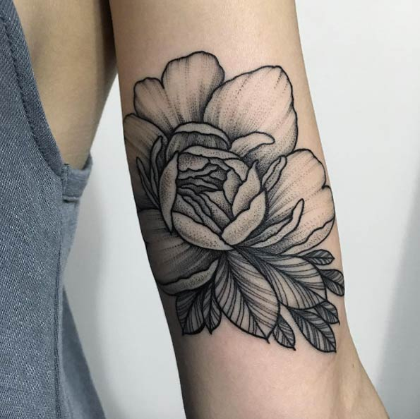 Black dotwork peony on the arm by sasha masiuk