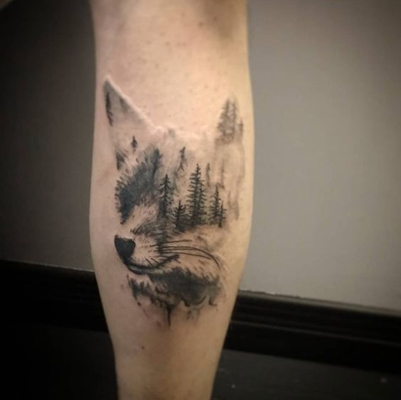 Black fox tattoo with woods inside