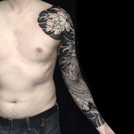 Black full sleeve traditional japanese style tattoo with a peony on the shoulder