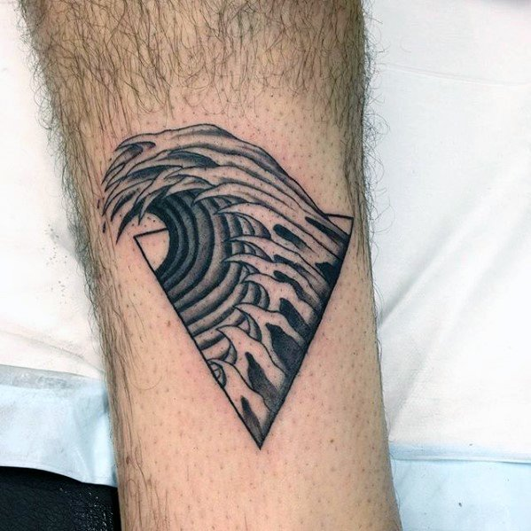 Black large wave coming out of the triangle tattoo on the calf