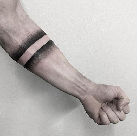 Black negative space armband tattoo