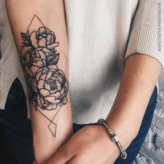 Black peonies and dotted lines tattoo on the right arm