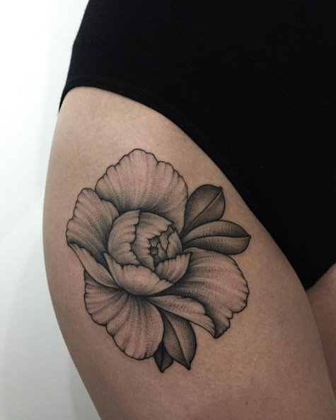 Black peony tattoo on the right hip by sasha masiuk