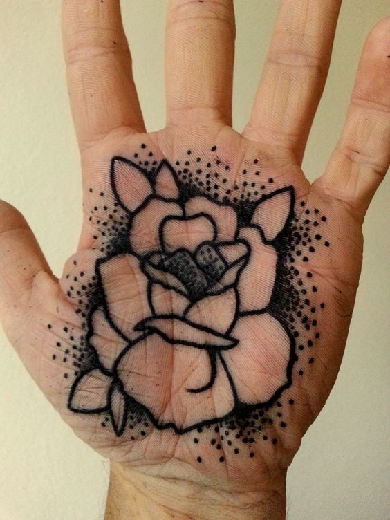 Black rose palm tattoo by luis marquardt