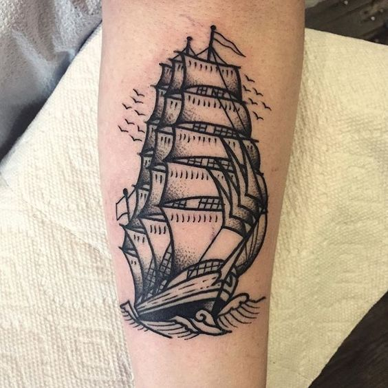 Black ship tattoo on the arm by christian lanouette
