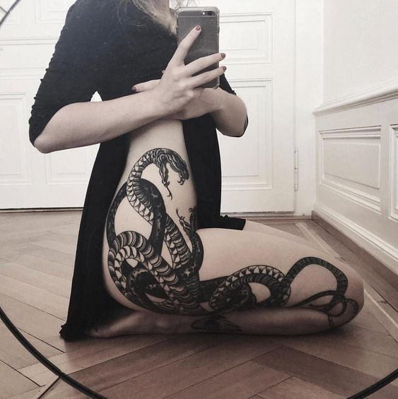 Black snake tattoo on the right hip and the leg