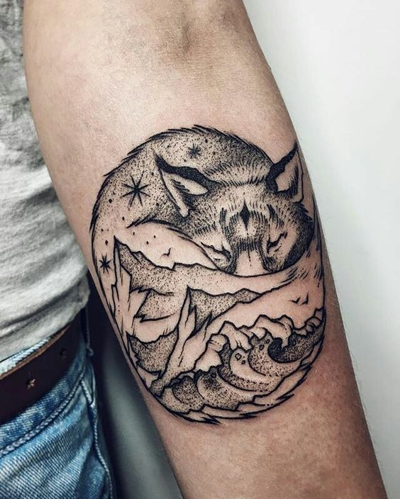 Black tattoo of a sleeping fox mountains and waves