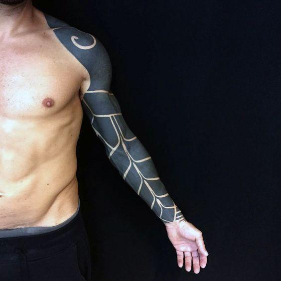 Blackout full sleeve negative space tattoo