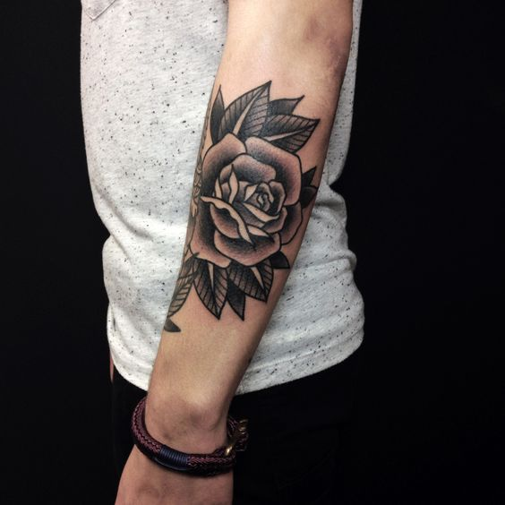 Blackwork rose tattoo on the left arm by tattoojoris