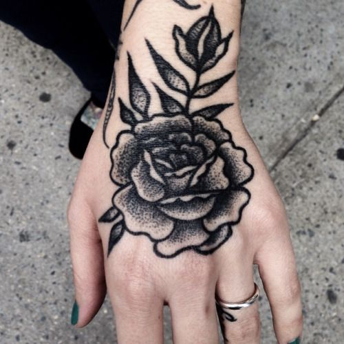 Blackwork rose traditional tattoo on the left hand