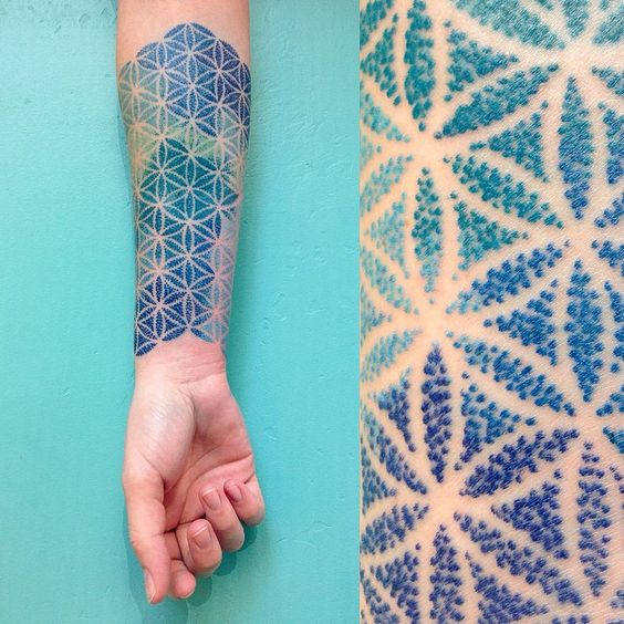 Blue flower of life tattoo on the arm