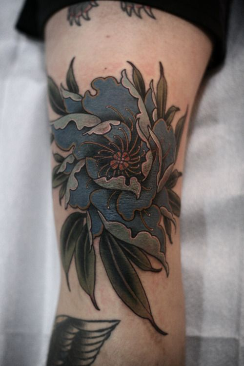 Blue peony tattoo on the leg