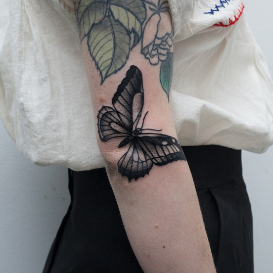 Butterfly tattoo on the right elbow