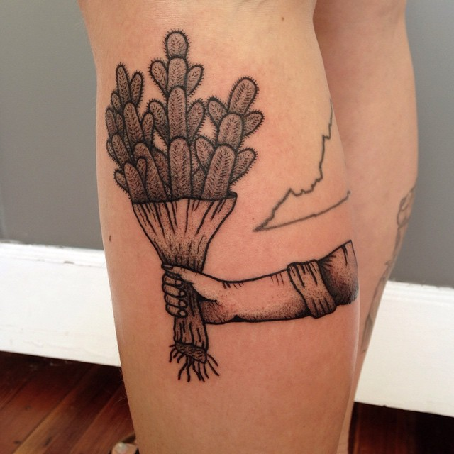 Cactus bouquet tattoo on the left calf