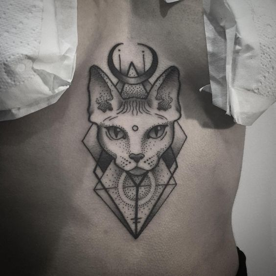 Cat tattoo on the sternum