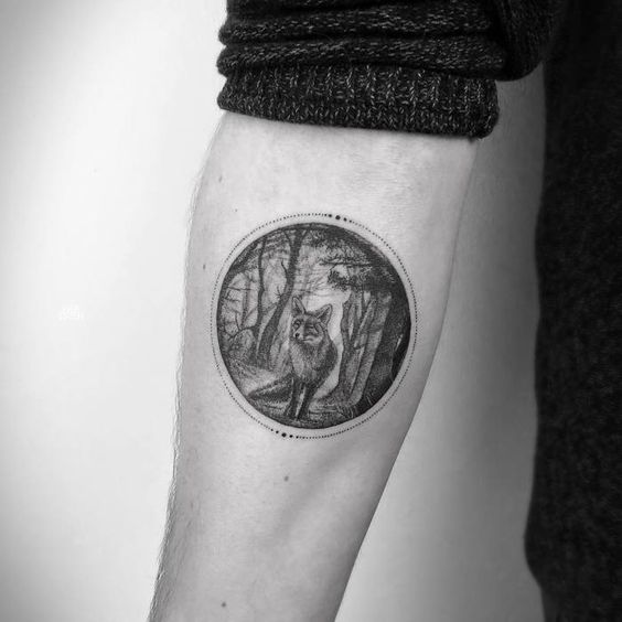 Circular tattoo of forest and fox