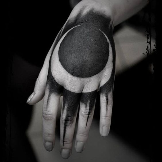 Crescent moon negative space tattoo on the hand