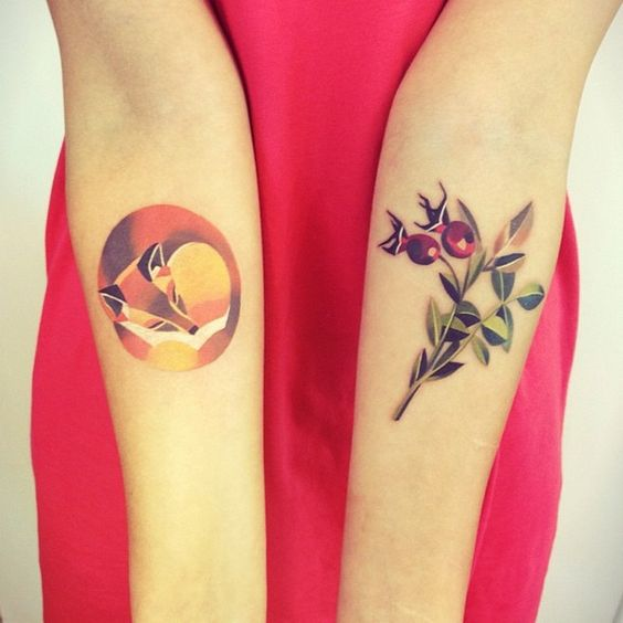 Curled up fox tattoo on the right inner arm