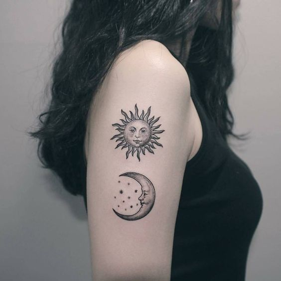 Cute sun and moon tattoo on the right upper arm