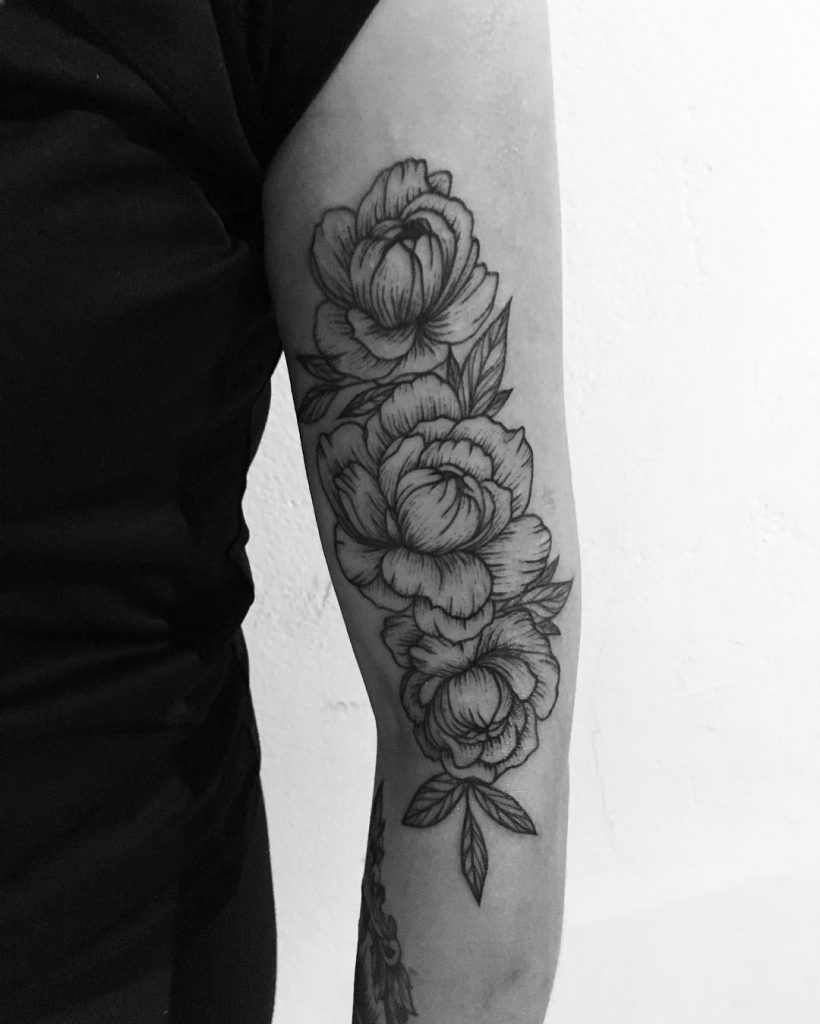 Delicate black three peonies tattoo on the left arm