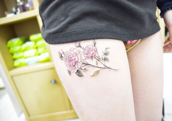 Delicate pink peony inked on the right thigh by banul