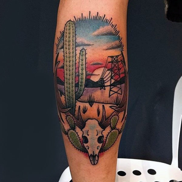 Desert landscape tattoo with a skull and a cactus