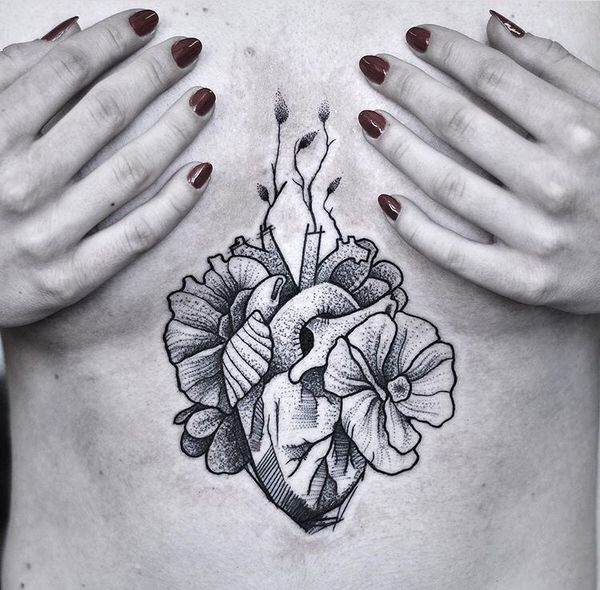 Dot work heart and flowers tattoo on the sternum