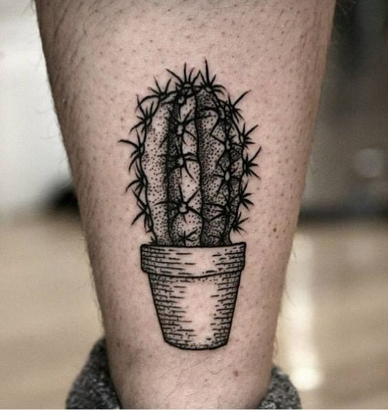 Dot work style black cactus with spines tattoo on the calf by pavlo balytskyi