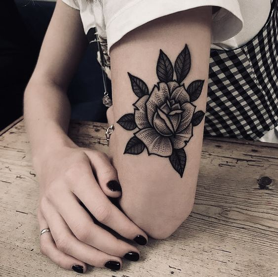 Dotwork black rose tattoo on the left upper arm